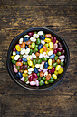 Bowl of colourful sweet jellybeans on dark wood - LVF06302