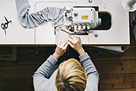 Top view of woman using sewing machine - JUBF00279