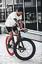 Young man on fixie bike in the city - VPIF00180