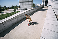 Young man riding skateboard in the city - VPIF00210