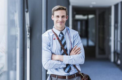 Portrait of smiling businessman - UUF11891