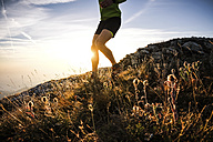 Italy, man running on mountain trail - SIPF01797