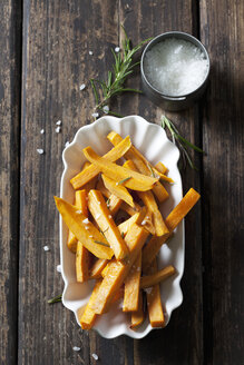 Sweet potato fries with rosmary and salt in porcelain bowl - CSF28323