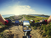 France, Bretagne, Sainte-Anne la Palud, Plage de Treguer, cell phone on mountain e-bike - LAF01911
