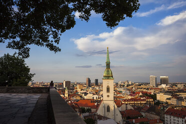 Slovakia, Bratislava, cityscape at sunset with St. Martin's Cathedral from hilltop terrace - ABOF00278