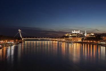 Slovakia, Bratislava, cityscape from Danube River at night - ABOF00293