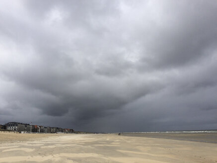 Belgium, Flanders Coast, De Haan, storm clouds and strong wind on North Sea beach - GWF05280