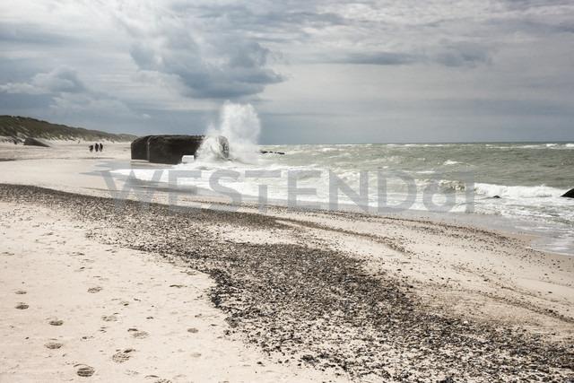 Denmark, Ulfborg, German Atlantic Wall bunker sinking in the sea - HWOF00215