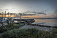 Germany, Eckernfoerde, view to Baltic sea with new light house at morning twilight - KEBF00636