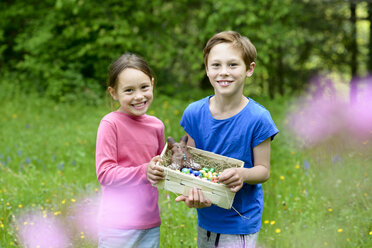 Portrait of little boy and girl holding Easter nest - LBF01666