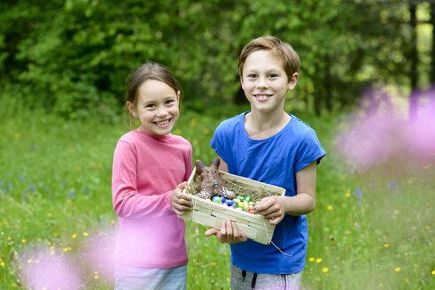Portrait of little boy and girl holding Easter nest - LBF01666