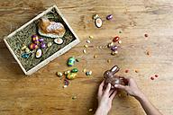 Hands filling Easter nest - LBF01669