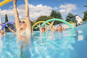 Group of seniors doing water gymnastics in pool - PNPF00102