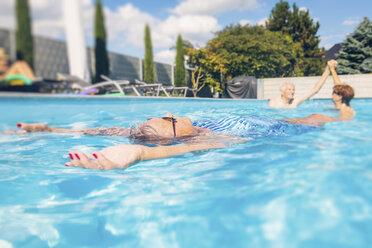 Seniors swimimng in swimming pool - PNPF00108