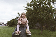 Father carrying his little daughter on shoulders - KMKF00009