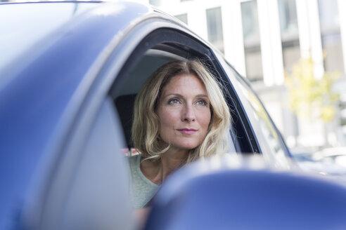 Portrait of woman in car looking sideways - PNEF00089