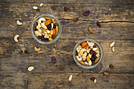 Two glasses of trail mix on dark wood - LVF06327