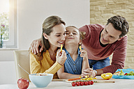 Happy family at home preparing healthy food - RORF01033