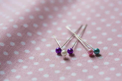 Fixing pins on cloth - NGF00427