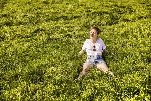 Woman in field enjoying sunlight - FMKF04556