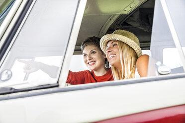 Two happy women in a van - FMKF04586