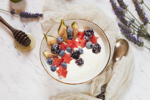 Bowl of Greek yoghurt with fig, watermelon, frozen berries and lavender honey - SBDF03321