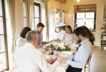 Family praying before Christmas dinner - HAPF02188