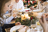 Family dining at Christmas dinner table - HAPF02197