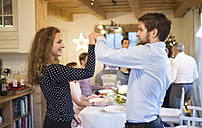 Young couple dancing on a Christmas party - HAPF02212