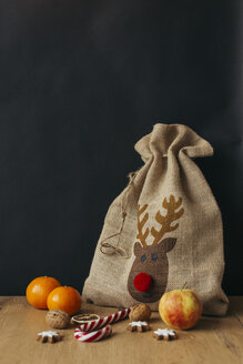 Gunny bag, fruits, candy cane, walnuts and cinnamon stars - JHAF00009