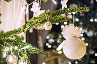 Fir branch with white Christmas decoration - PUF00773