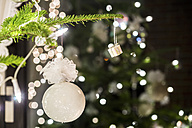 Fir branch with white Christmas decoration - PUF00779