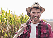 Portrait of happy farmer on field - UUF11903