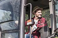 Smiling farmer on tractor - UUF11924