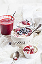 Bowl of natural yoghurt with raspberry sauce and frozen fruits - SBDF03329