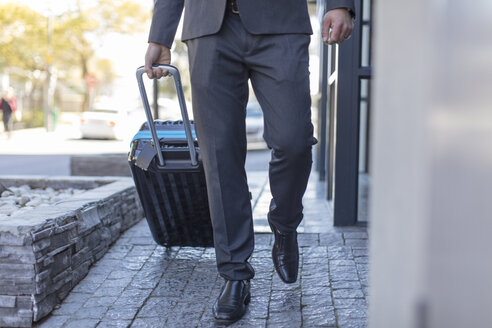 Businessman walking with luggage - ZEF14644