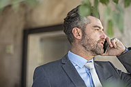 Businessman talking on cell phone - ZEF14650