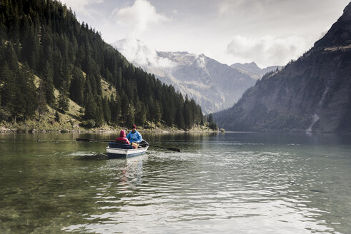 Austria, Tyrol, Alps, couple in rowing boat on mountain lake - UUF11956