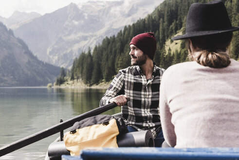 Austria, Tyrol, Alps, couple in rowing boat on mountain lake - UUF11959