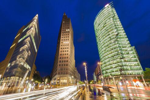 Germany, Berlin, Potsdamer Platz, illuminated skyscrapers - WDF04166