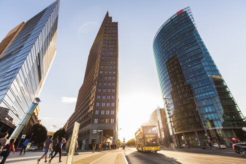 Germany, Berlin, Potsdamer Platz, skyscrapers and double-decker bus at backlight - WD04183