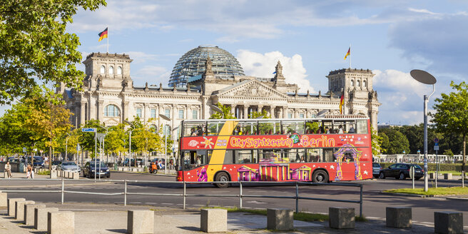 Germany, Berlin, view to Reichstag building with tour bus in front - WD04186