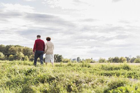 Senior couple on a walk in rural landscape - UUF12038
