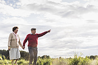 Senior couple on a walk in rural landscape - UUF12041