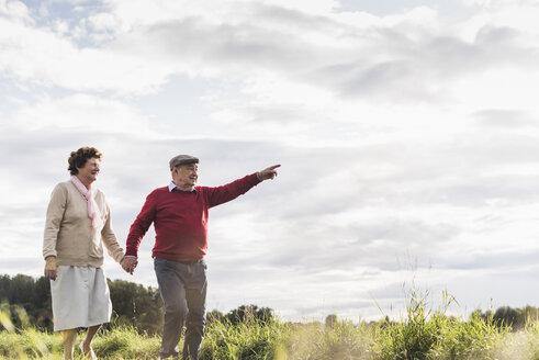 Senior couple on a walk in rural landscape - UUF12041