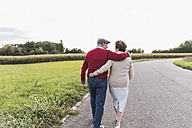 Senior couple on a walk in rural landscape - UUF12053