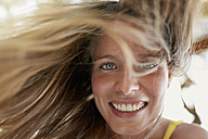 Portrait of laughing young woman with blowing hair - PNEF00219