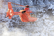 Germany, Berchtesgadener Land, flying helicopter in winter - MMAF00154