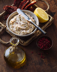 Bowl of compound butter with dried tomatoes and olives - PPXF00112