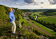 Germany, Bavaria, Arnsberg, Senior woman looking over Arnsberger Leite - SIEF07565